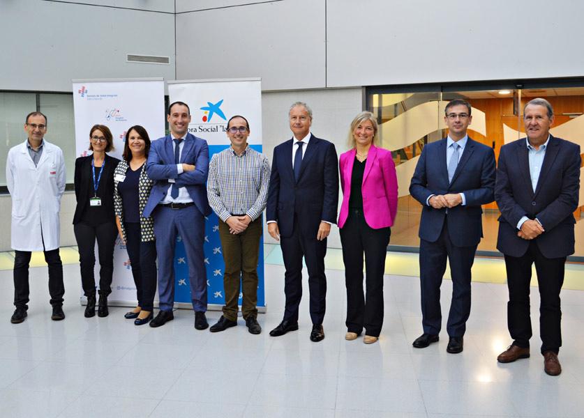 Representants de La Caixa i SSIBE durant la presentació del conveni, la setmana passada. (Foto: SSIBE).